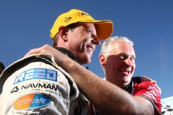 James Courtney celebrates an emotional victory with Dick Johnson Racing's sporting director Adrian Burgess