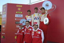 Felipe Massa, Stefano Domenicali and Fernando Alonso on a podium