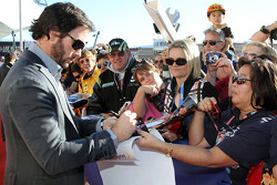 Five-time NASCAR Sprint Cup Series Champion Jimmie Johnson signs autographs