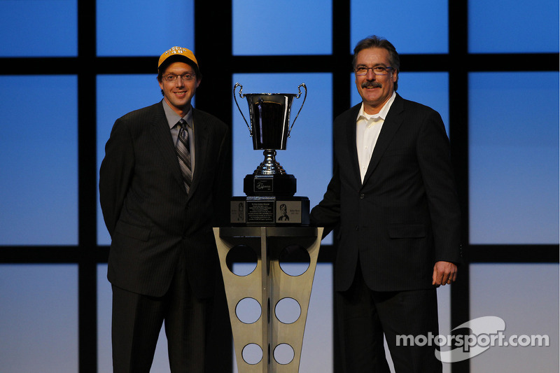 National Motorsports Press Association President Dustin Long poses with Scott Hunter, son of the late NASCAR Vice President of Corporate Communications Jim Hunter, the recipient of the Myers Brothers Award at the Bellagio