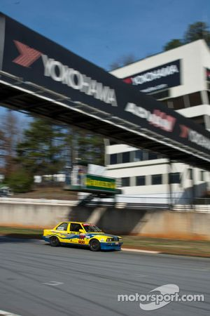 #191 Team Palacio Racing 1990 BMW 325i yellow/b: Arjun Soundararajan, Eric Palacio, Julio Palacio