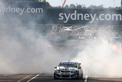 James Courtney celebrates after taking out the 2010 V8 Supercars Championship for Jim Beam Racing