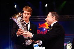 FIA President Jean Todt presents Formula One World Champion Sebastian Vettel with the Drivers' troph