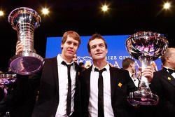 Le champion du monde FIA Formula One Sebastian Vettel et le champion FIA World Rally Sébastien Loeb