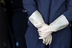 Mercedes GP mechanic uses gloves because of the KERS system