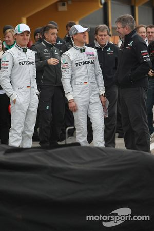 Nico Rosberg, Mercedes GP F1 Team and Michael Schumacher, Mercedes GP F1 Team with Ross Brawn Team Principal, Mercedes GP