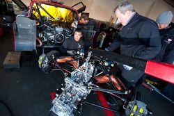 Flying Lizard Motorsports team members at work