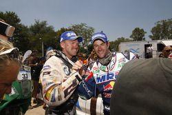 #16 BMW: Frans Verhoeven y #1 KTM: Marc Coma
