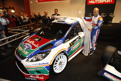 Gerard Quinn, Donald Smith and Mikko Hirvonen unveil the all new Ford Fiesta RS WRC at the 2011 Autosport International Show in Birmingham