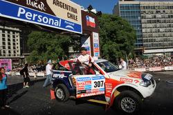 #307 BMW: Krzysztof Holowczyc and Jean-Marc Fortin