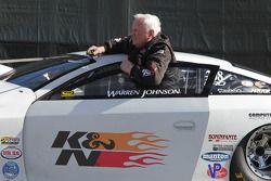 Warren Johnson wating to be weighed at the scales aboard his K&N Filters Chevy Cobalt