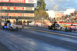 Team mates Antron Brown (left) Tony Schumacher (right) during final round of qualifying during the Kragen Oreilly Auto Parts NHRA Winternationals