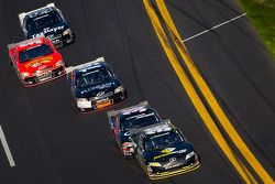 Michael Waltrip, Pastrana Waltrip Racing Toyota leads a group of cars