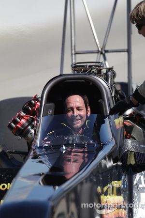 Reflective shot of Troy Buff in his BME/Okuma Top Fuel dragster