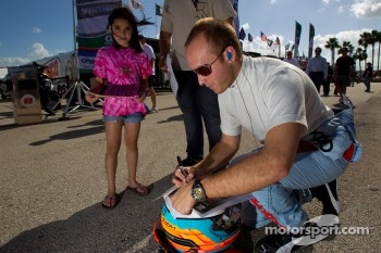 Jeff Segal signs an autograph for a young fan