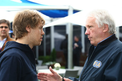 Sebastian Vettel, Red Bull Racing with Charlie Whiting, FIA Safety delegate, Race director & offical