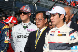 Michael Schumacher, Mercedes GP Petronas F1 Team and The F1 drivers stand for a minute silence for Japan