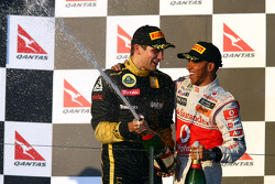 Podium: third place Vitaly Petrov, Lotus Renault GP and Lewis Hamilton, McLaren Mercedes