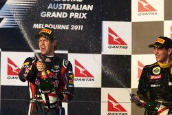 Podium: first place Sebastian Vettel, Red Bull Racing and Vitaly Petrov, Lotus Renault GP