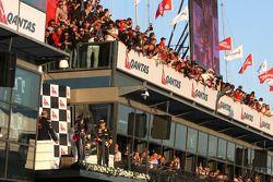 Podium: Lewis Hamilton, McLaren Mercedes, Sebastian Vettel, Red Bull Racing and Vitaly Petrov, Lotus