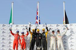 LM GTE Pro podium: class winners Robert Bell and James Walker, second place Giancarlo Fisichella and