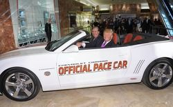 Donald Trump settles into his new ride as the 2011 Indianapolis 500 Chevrolet Camaro SS Convertible Pace Car driver for the 100th Anniversary of the Indianapolis 500 with Jeff Belskus, CEO, Indianapolis Motor Speedway (L)
