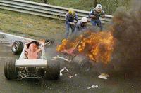 Niki Lauda, Ferrari 312T2 on fire after crashing near Bergwerk corner