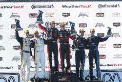 Overall podium: winners Eric Curran, Dane Cameron, Action Express Racing, second place Christian Fittipaldi, Joao Barbosa, Action Express Racing, third place Ricky Taylor, Jordan Taylor, Wayne Taylor Racing