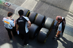 Pirelli tyre technician with Sahara Force India F1 Team mechanics