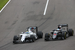 Felipe Massa, Williams FW38 and Fernando Alonso, McLaren MP4-31 battle for position