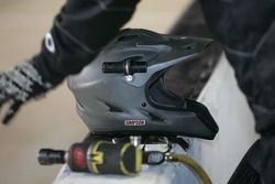 Flashlights mounted on pit helmets for night racing