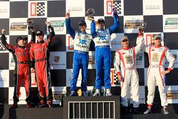 DP podium: class and overall winners Scott Pruett and Memo Rojas, second place Jon Fogarty and Alex