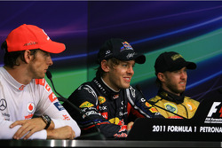 Post-race press conference: race winner Sebastian Vettel, Red Bull Racing, second place Jenson Button, McLaren Mercedes, third place Nick Heidfeld, Lotus Renault F1 Team