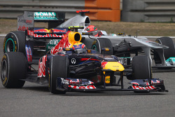 Mark Webber, Red Bull Racing and Michael Schumacher, Mercedes GP