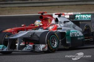 Fernando Alonso, Scuderia Ferrari and Michael Schumacher, Mercedes GP