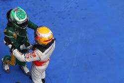 Race winner Lewis Hamilton, McLaren Mercedes and Heikki Kovalainen, Team Lotus