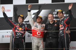 Podium: race winner Lewis Hamilton, McLaren Mercedes, with second place Sebastian Vettel, Red Bull R