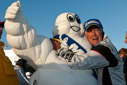 Greg Pickett hugs the Michelin Man