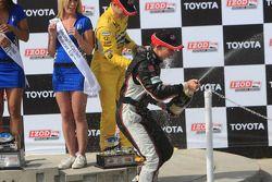 Champagne celebration on the podium