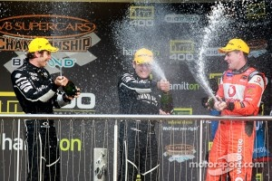 Race winner Rick Kelly, second place Craig Lowndes, third place Todd Kelly