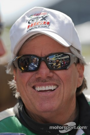 John Force smiles for the cameras