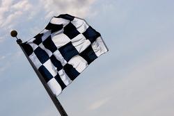A checkered flag waves