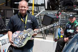 Sam Bass holds the Gibson guitar trophy that he painted for the Nashville 300 race