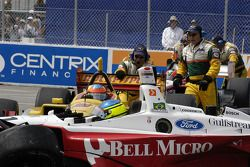Cristiano da Matta still in his car while Timo Glock is pulled from the wreck