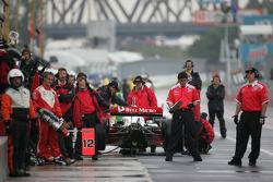 PKV Racing crew members wait for Jimmy Vasser