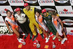 Podium: race winner Justin Wilson with Oriol Servia and Alex Tagliani