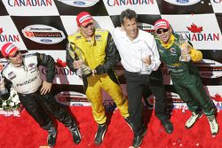 Podium: race winner Justin Wilson with Oriol Servia, Alex Tagliani and team owner Carl Russo