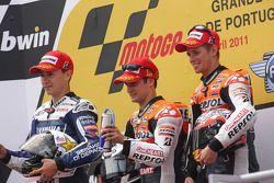 Podio: ganador de la carrera Dani Pedrosa, segundo lugar Jorge Lorenzo y tercer lugar Casey Stoner