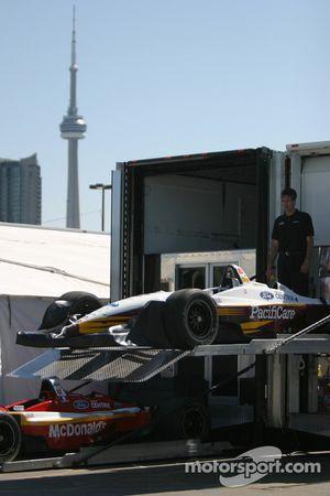 Newman Haas Racing crew member unload the cars