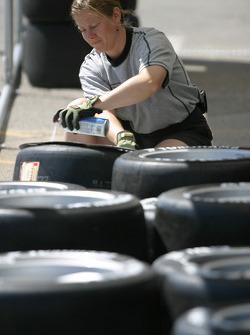 Bridgestone crew member prepares tires